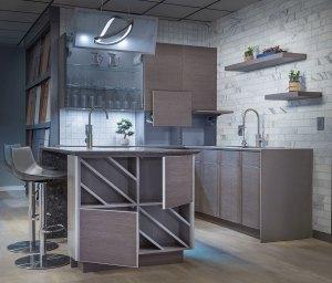 Custom handleless kitchen in wirebrushed oak with caesarstone quartz counters and marble backsplash.