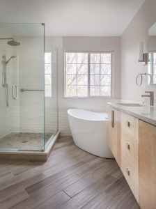 Transitional bathroom with floating vanity, freestanding tub and corner shower.