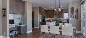 Grey transitional custom kitchen with white glass backsplash and white island.