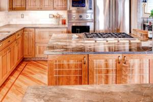 Custom cherry kitchen cabinetry with oak applied sticking and pegs on large island in kitchen remodel in Denver, CO.