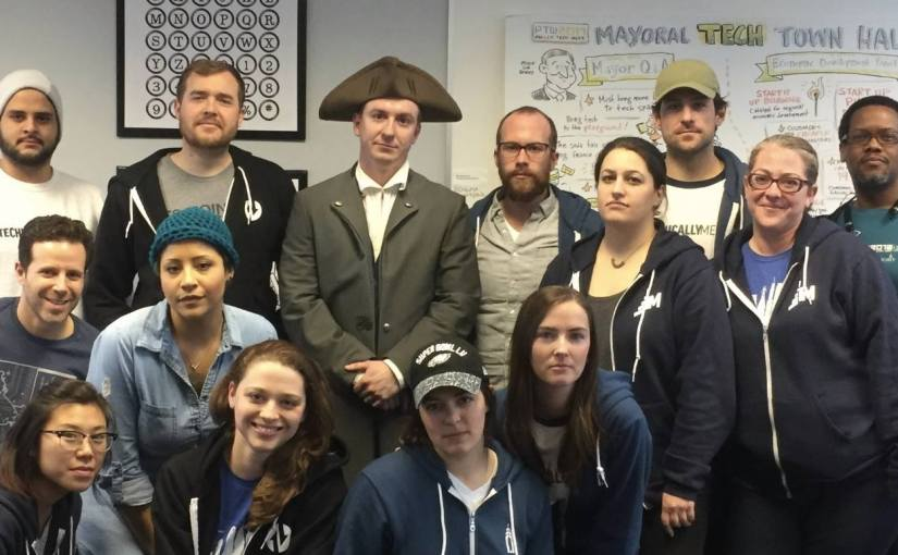 Photo of some of the Technically Media staff mean-mugging with an actor portraying Young Ben Franklin
