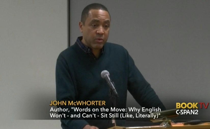 John McWhorter standing at a podium appearing on CSPAN2 during a talk