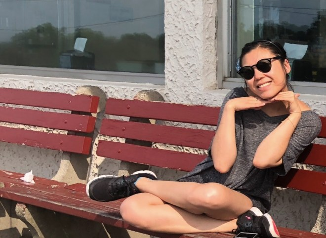 Jane is on a park bench with a warm smile