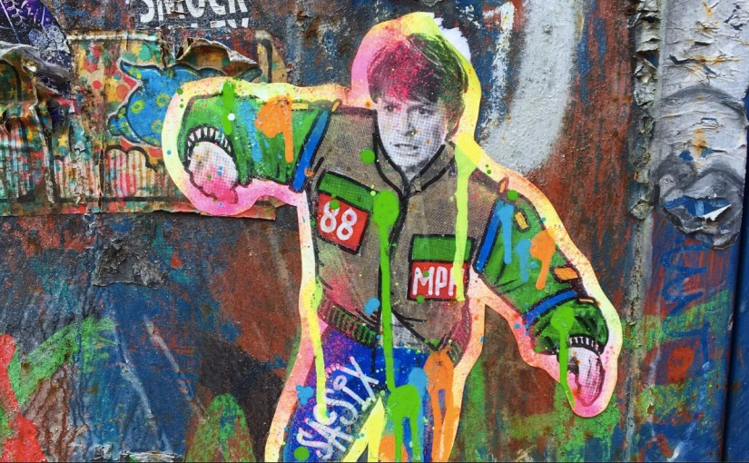 Colorful print of Michael J Fox from Back to the Future on a muraled wall in Williamsburg Brooklyn
