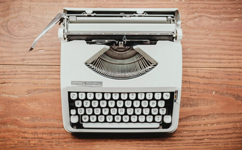 overhead photo of a white typewriter