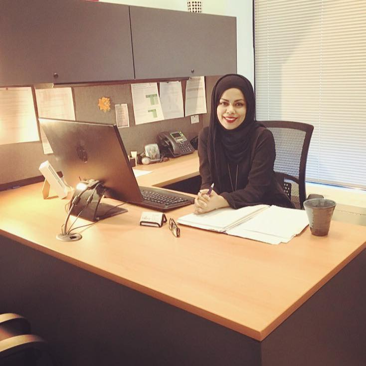 Silmy Abdullah sitting at her desk at the law office
