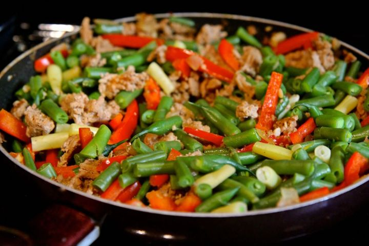 Szechuan Green Bean Stirfry with Minced Turkey - this healthier spin on Chinese takeout is gluten-free, low carb, paleo and dairy free! Recipe by Christy Brissette, media dietitian, 80 Twenty Nutrition