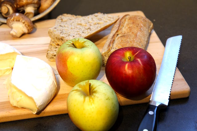 Apples and brie on cutting board Apple Brie Panini with Mushrooms - Vegetarian and Gluten-Free - media registered dietitian Christy Brissette 80 Twenty Nutrition