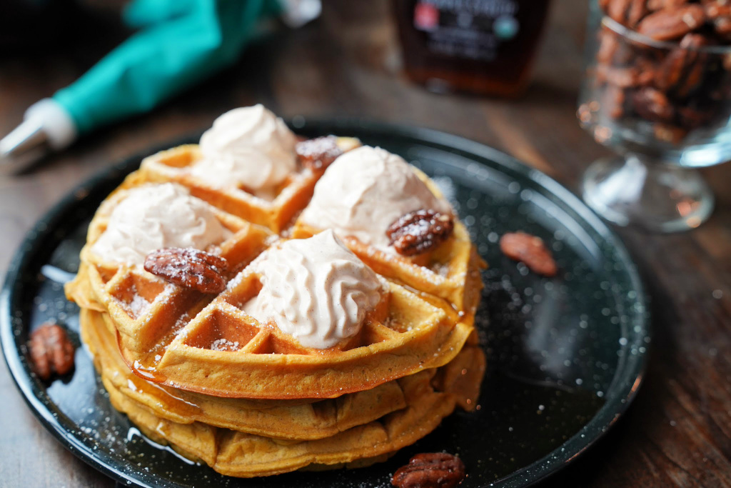 waffles with whipped cream and candied pecans