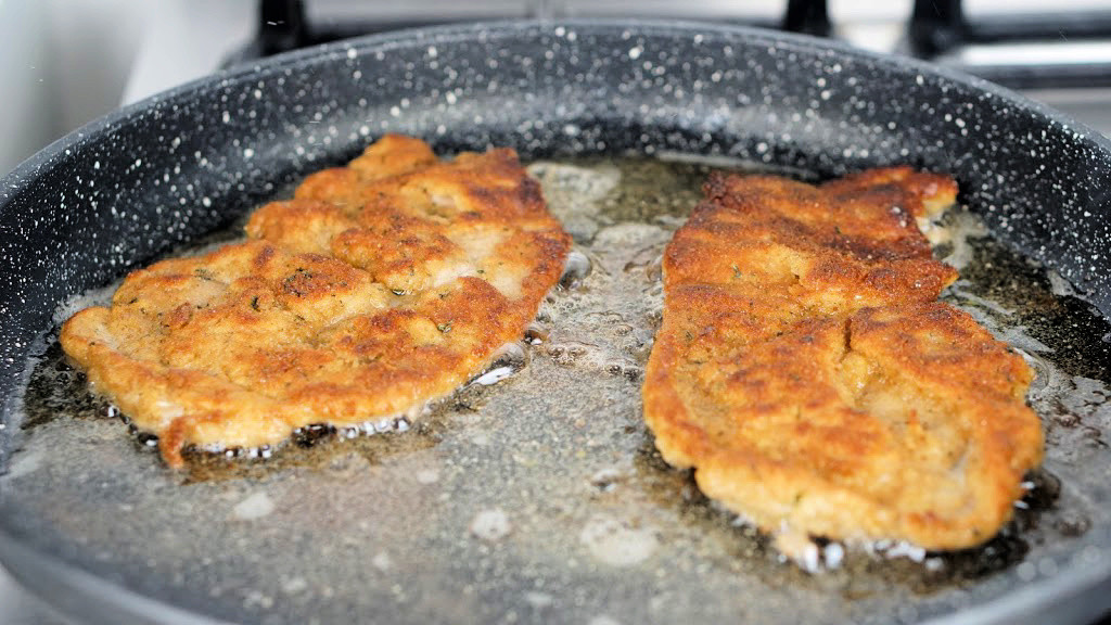 Veal Schnitzel cooking in frying pan