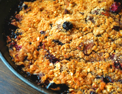 Mixed berry crisp in cast iron pan