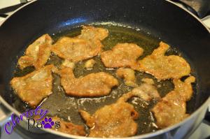 Making chicken cat treats from chicken skin