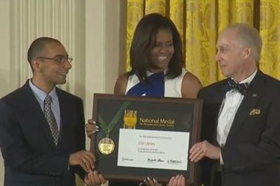 Michelle Obama presents award to Bassem Gayed and Robert Farwell of the Otis Library