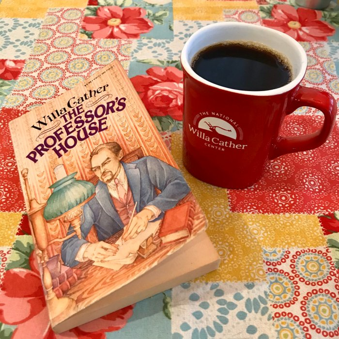 Photo of Willa Cather's 1925 novel, The Professor's House along side a mug from The National Willa Cather Center.