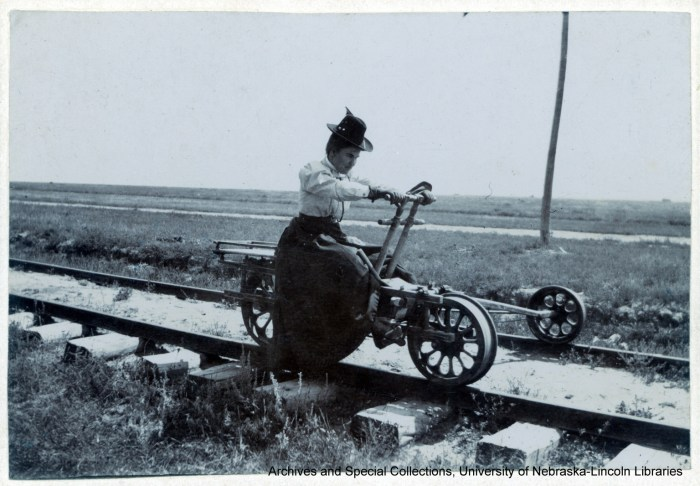 Willa Cather driving a handcar in Wyoming 1898