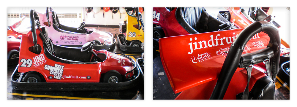 Side view and top-down view of the rear spoiler that features their URL and sub-brand logos of their produce range.
