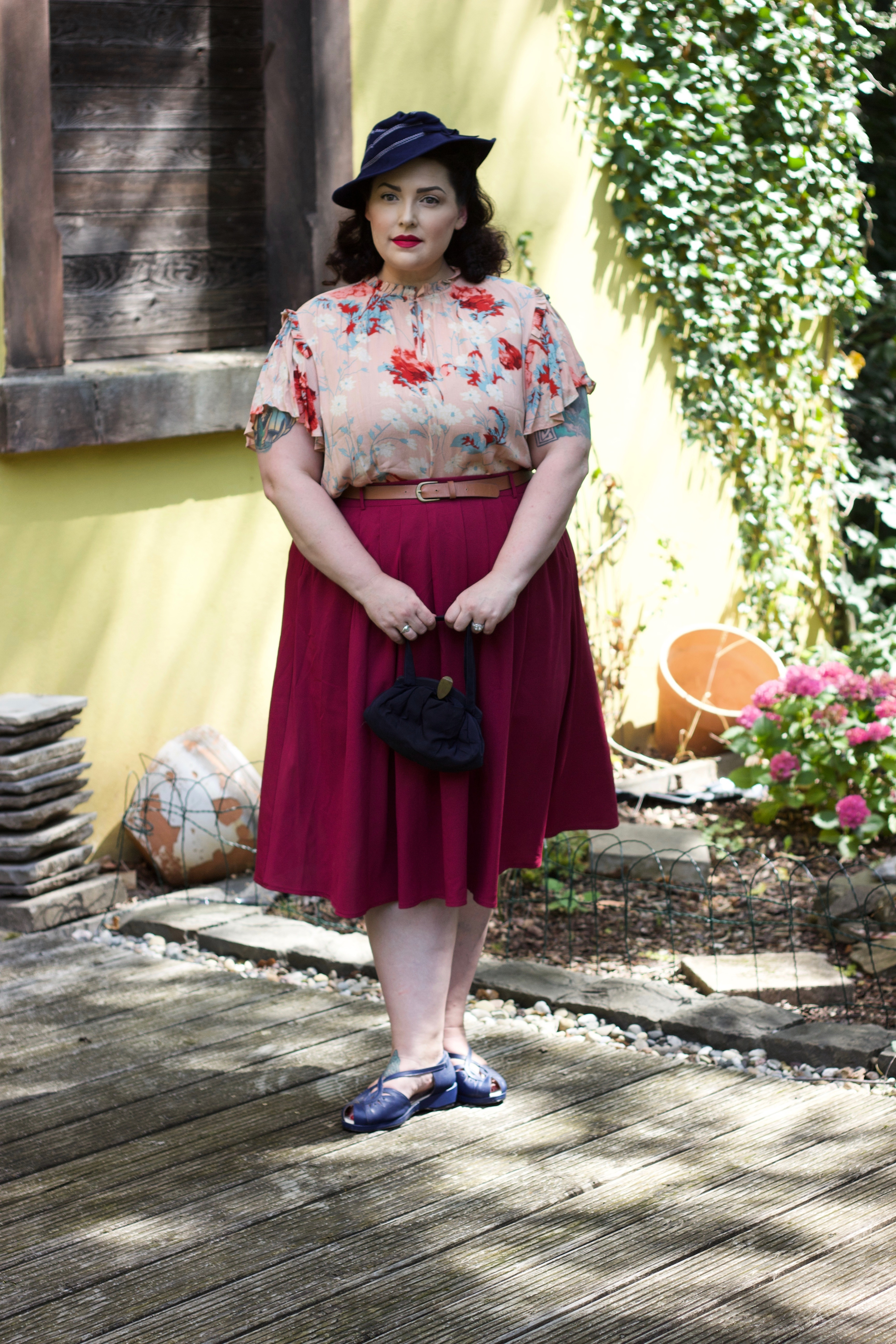 Vintage Style Plus Size Woman in Red Skirt, pink blouse and blue hat