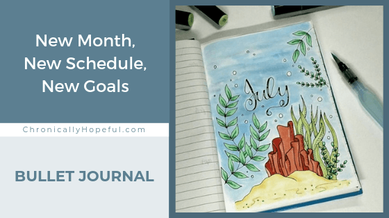 A journal on the table, featuring a cover page for July with an under the sea theme featuring coral and seaweed. Title reads: New Month, New Schedule, New Goals. Bullet Journal.
