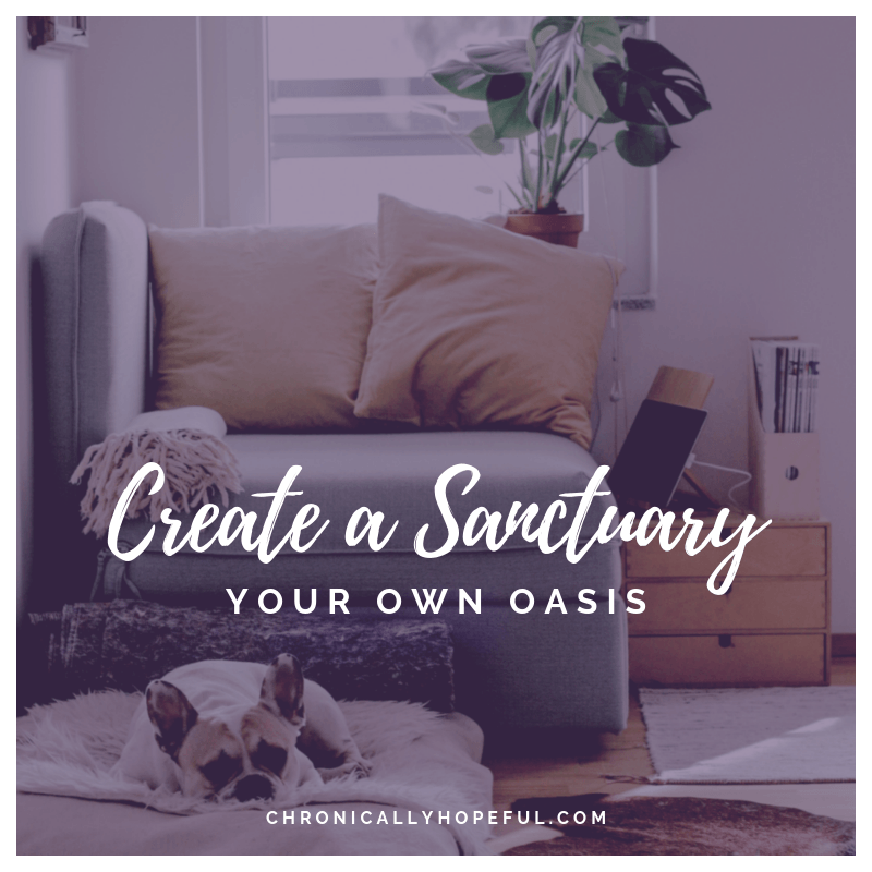A cosy sofa by a window. With cushions, throw, plant and a puppy on the floor. Quote reads, create a sanctuary, your own oasis.