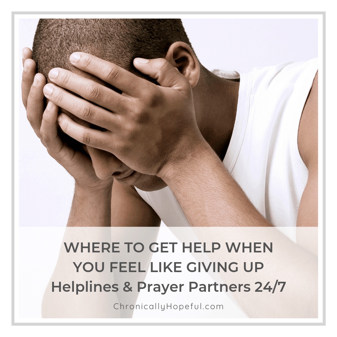 Man holding his head in his hands. Title Reads, Where to get help when you feel like giving up. Helplines & Prayer Partners available 24/7 Worldwide.