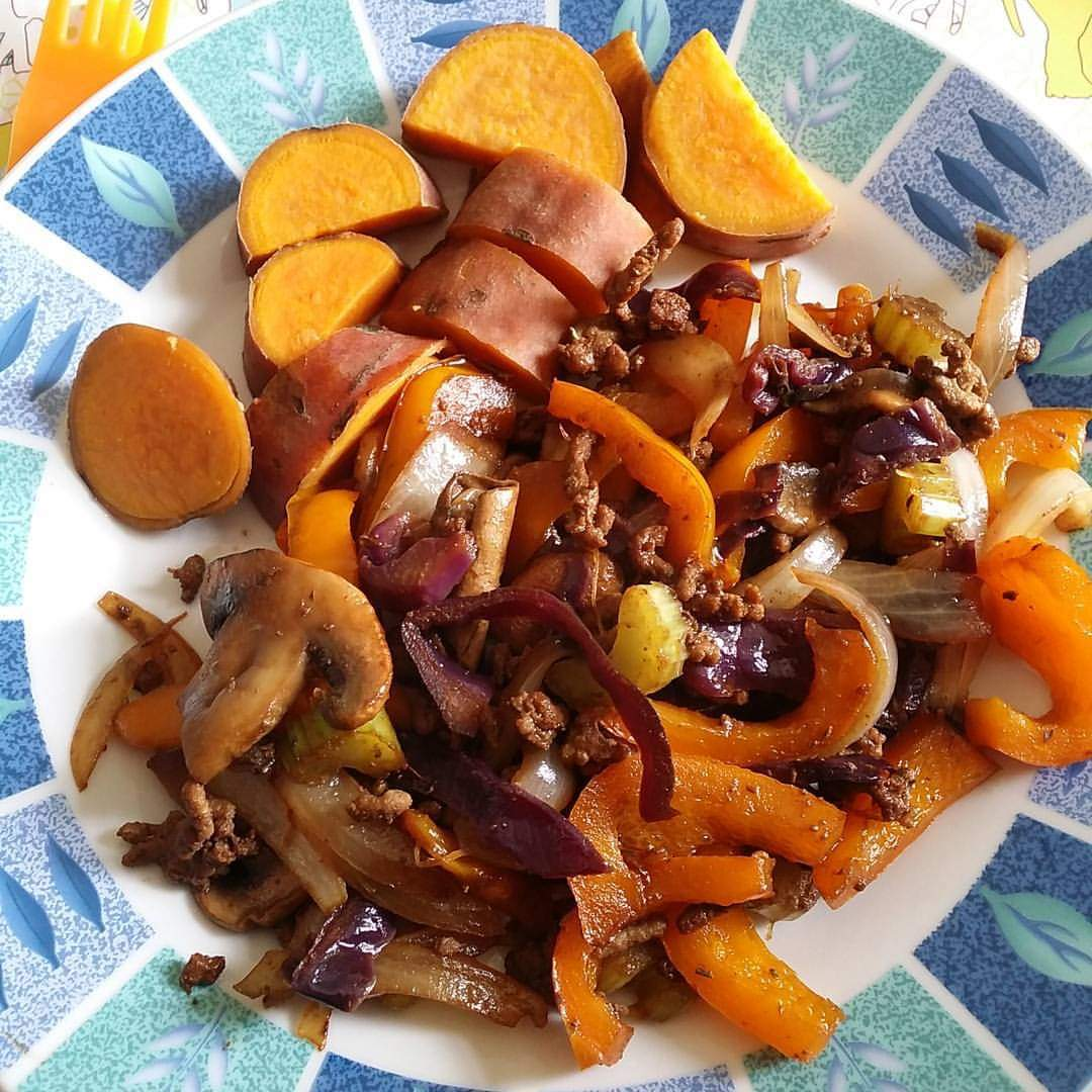 Spicy stir-fry with sweet potato wedges on the side.