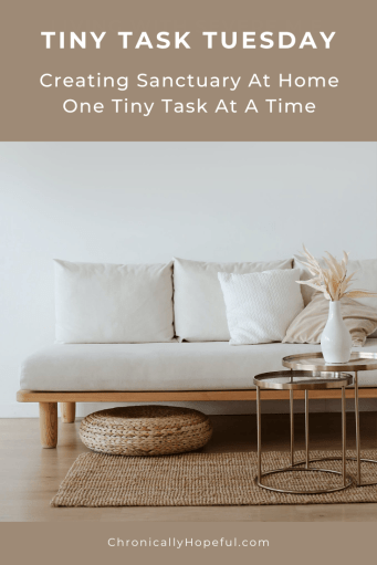 A sofa with comfy cushions and a vase of dried flowers on a copper table. Title reads: Tiny task Tuesday, Creating sanctuary at home, one tiny task at a time