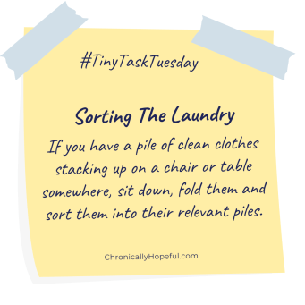 A post-it note with this week's Tiny Task Tuesday, sort the clean laundry