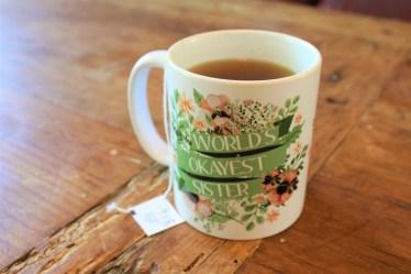mug of hot tea on wood coffee table