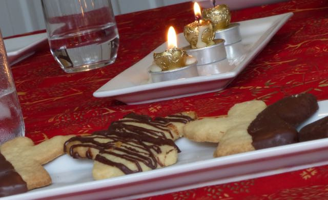 Vicarious pleasures from making Christmas cookie angels and dipping them in chocolate