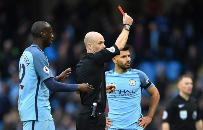 Sergio Aguero is shown a Red Card for a nasty tackle on David Luiz
