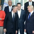 Trump speaks with NATO secretary-general, Jens Stoltenberg. Left is Germans leader, Merkel
