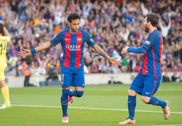 Neymar and Lionel Messi celebrate after Barcelona score against Villarreal