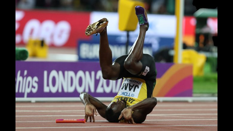 Jamaica's Usain Bolt falls after injuring himself in the final of the men's 4x100m relay