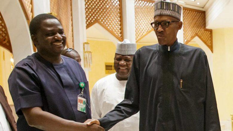 Femi Adesina (left) shakes President Muhammadu Buhari