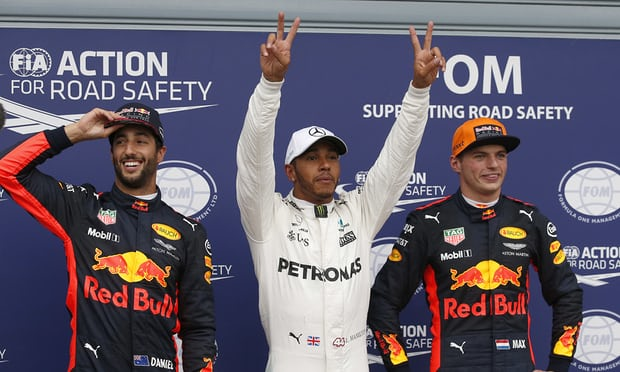 Mercedes's Lewis Hamilton, centre, celebrates pole position, between Daniel Ricciardo, left, who is third and his Red Bull team-mate Max Verstappen, second