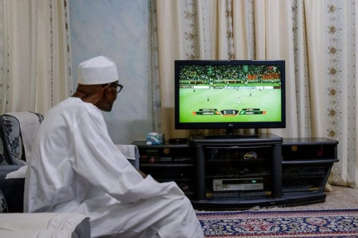 President Buhari watching the Super Eagles in action, calls for celebration