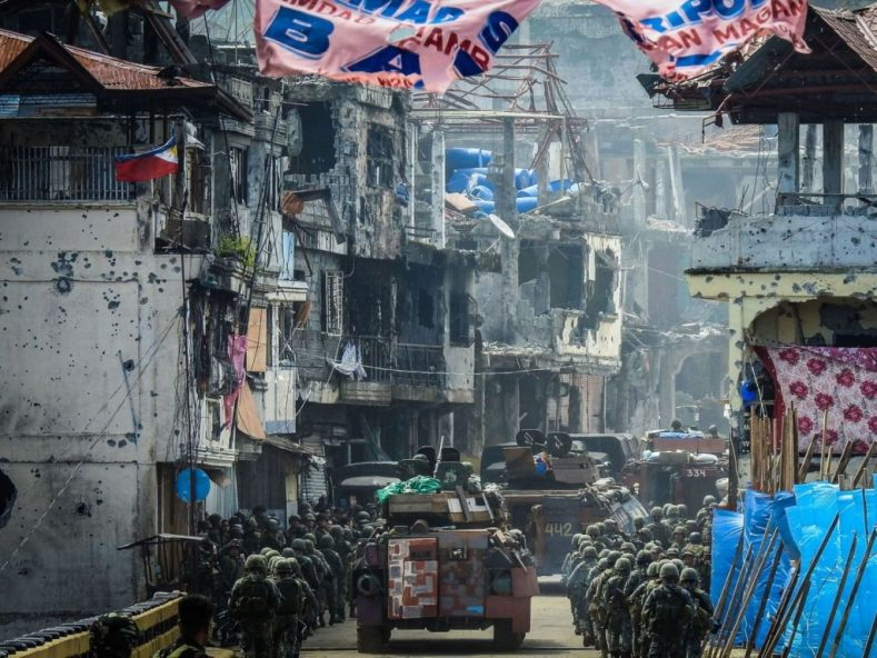 Philippine forces marching in Mindanao as they fight pro-Islamic State militants