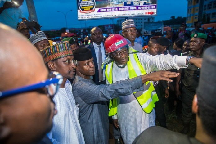 Acting President Osinbajo flanked by Minister of State; Mohammed Bello and FEMA official