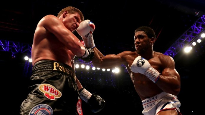 Anthony Joshua knocks out Alexander Povetkin in the seventh round of their heavyweight fight in Wembley1
