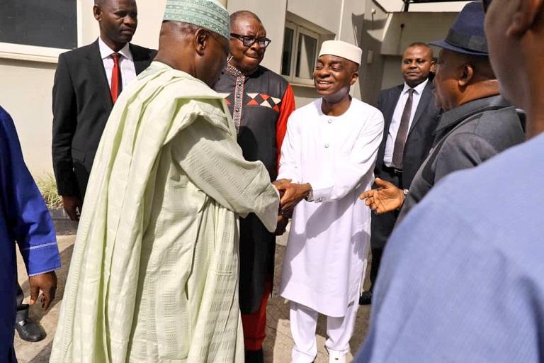 Atiku Abubakar shaking hands with Bishop David Oyedepo