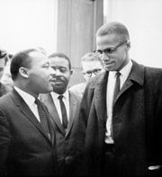 Malcom X towers impressively over Martin Luther King.