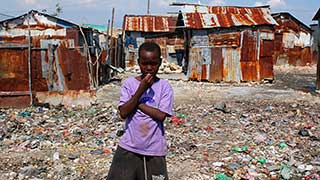 Before the earthquake, Haitians live under rusty sheet metal. Guess they'll have to put it back up.