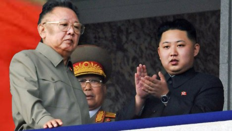 Who's that standing behind Kim Jong Il?