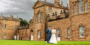 Bride and Groom infront of the venue of their micro-wedding in Hamilton, Lanarkshire