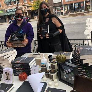 Author Sara A. Noë with a fan at a book signing at HotSpot Café, October2020