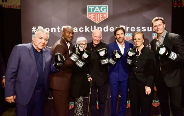 NEW YORK, NY - OCTOBER 25: (L-R) George Chuvalo, Evander Holyfield, Iris Apfel, Jean-Claude Biver, Henrik Lundqvist, Lonnie Ali, and Tom Brady attend the Muhammad Ali tribute event at Gleason's Gym on October 25, 2016 in New York City. (Photo by Eugene Gologursky/Getty Images for TAG Heuer)