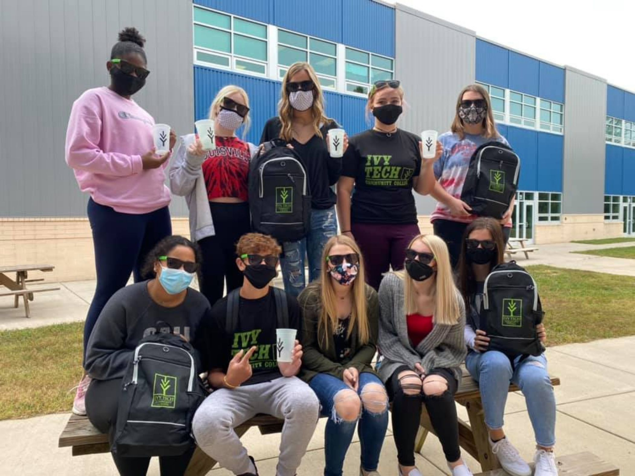 Students posing with Ivy Tech gear