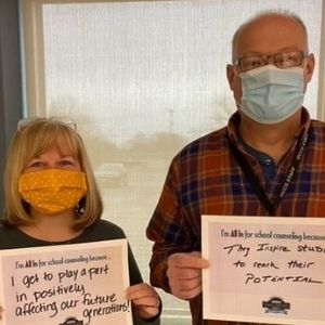 Counselors pose with signs saying why they are all in for counseling