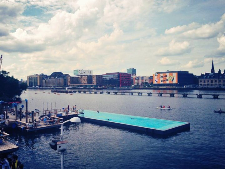 berlins-arena-badeschiff-pool-floats-inside-of-the-river-spree-where-visitors-can-swim-in-clean-water-and-enjoy-views-of-the-surrounding-city-food-drinks-music-and-lounge-chairs-are-also-available-from-open-to-close