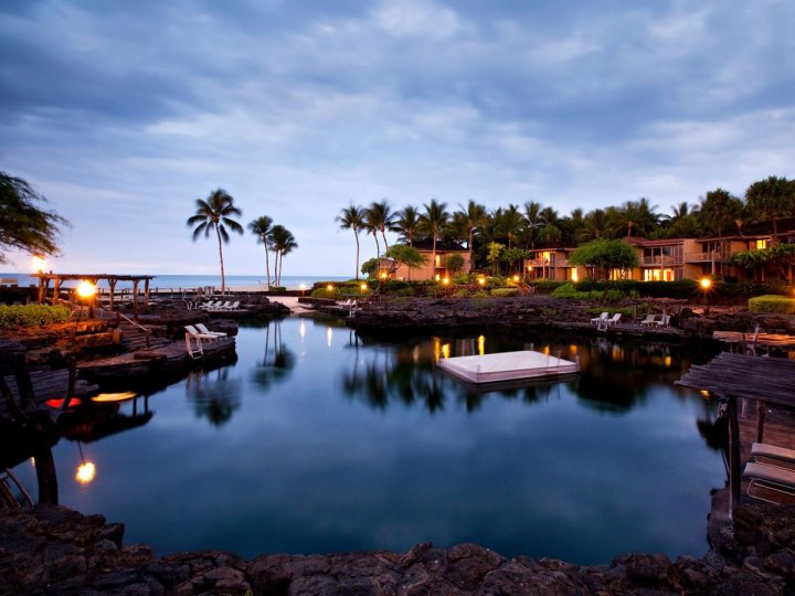 the-kings-pond-at-the-four-seasons-resort-hualalai-a-pool-of-18-million-gallons-is-carved-out-of-natural-lava-rock-swim-with-manta-rays-and-more-than-3000-tropical-fish-in-this-fresh-and-ocean-water-pool